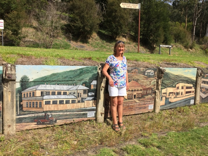 Bronwyn with murals at Warburton Station.