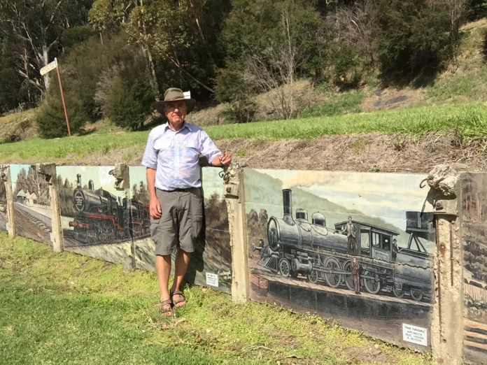 Roy with murals at Warburton Station.