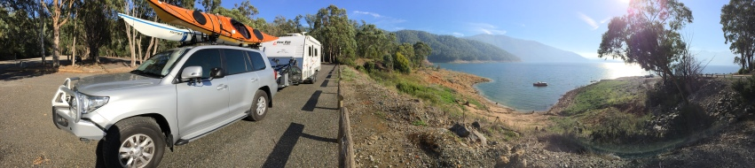 Lake Dartmouth morning panorama. View includes car, kayaks, tandem bike and caravan.