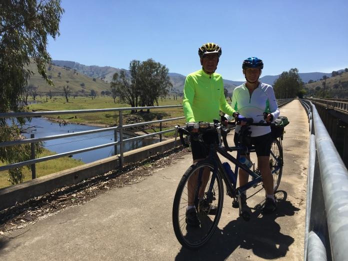 Bronwyn, Roy and tandem bike on bridge beside Murray Valley Highway near Old Tallangatta.